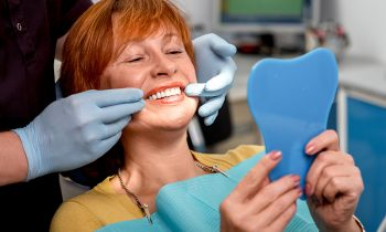 woman choosing dentures or dental implants